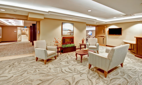 3 big whitte chairs in a lobby in a retirement home whitby, assisted living whitby