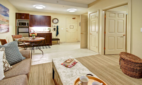 a large bedroom with a kitchenette in a retirement home whitby, assisted living whitby