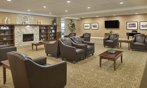 Lobby with fireplace at Bolton Mills Retirement Community